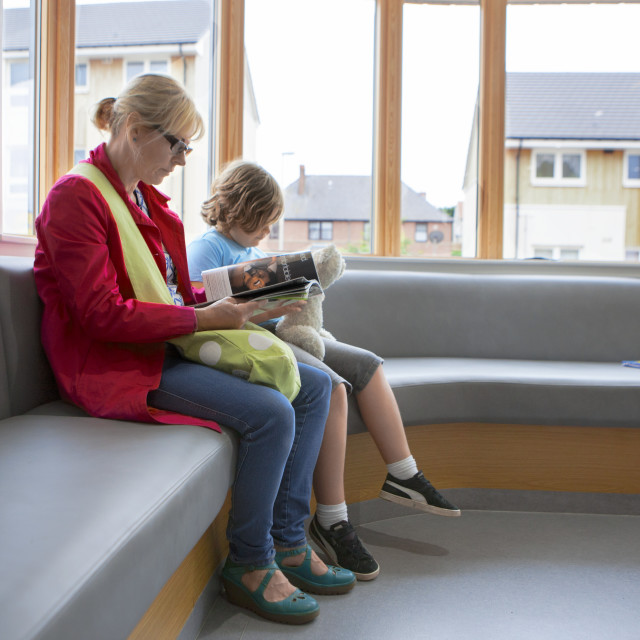 """Mother and son in waiting room"" stock image"
