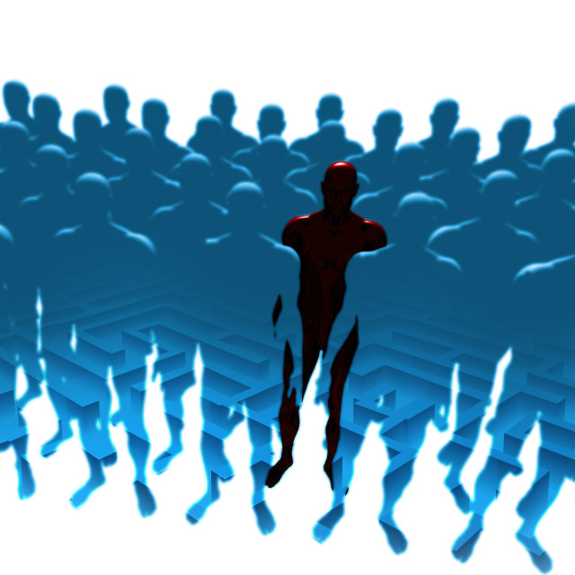 """Human figure standing out from the crowd"" stock image"