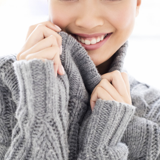 """""""Woman wearing grey knitted sweater"""" stock image"""