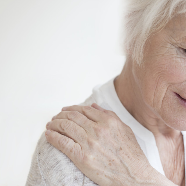 """Senior woman rubbing sore shoulder"" stock image"