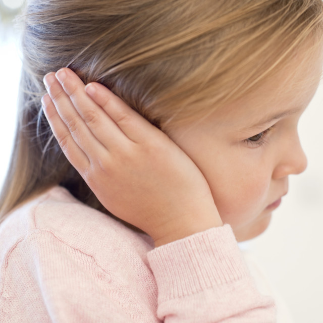 """""""Young girl with ear ache"""" stock image"""