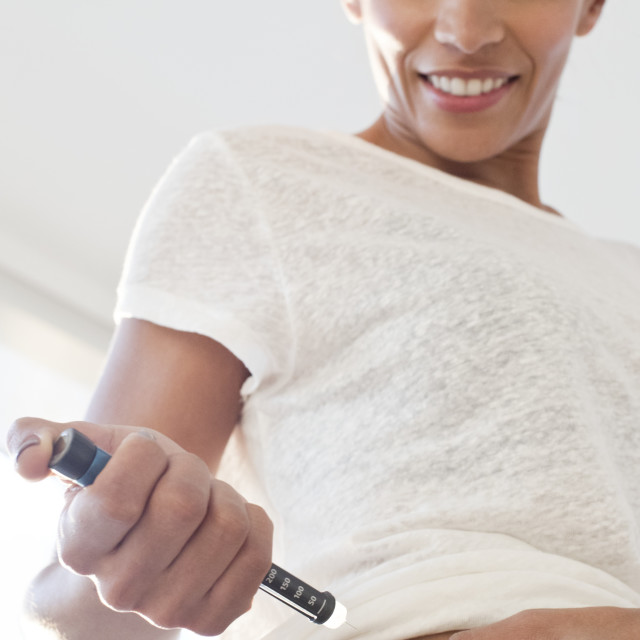 """""""Woman injecting herself in tummy"""" stock image"""