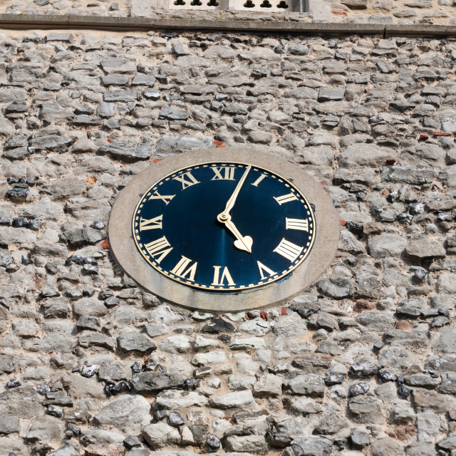"""stunning old clock outside on church brick wall"" stock image"