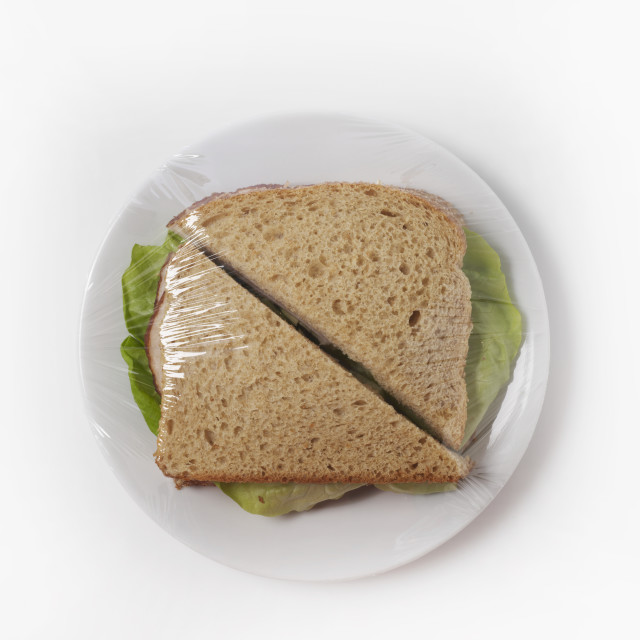 """Sandwich On A Plate With Plastic Wrap"" stock image"