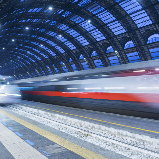 """""""Motion Blur Of Speeding Train In Train Station; Milan, Lombardy, Italy"""" stock image"""