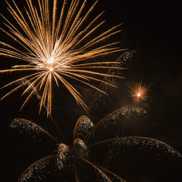 """Gold And White Fireworks Against A Black Sky Background At Night; Laval,..."" stock image"