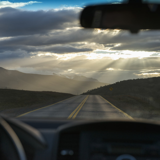 """""""Rays Of Sunlight Shining Through The Clouds Onto The Road As Viewed Through..."""" stock image"""