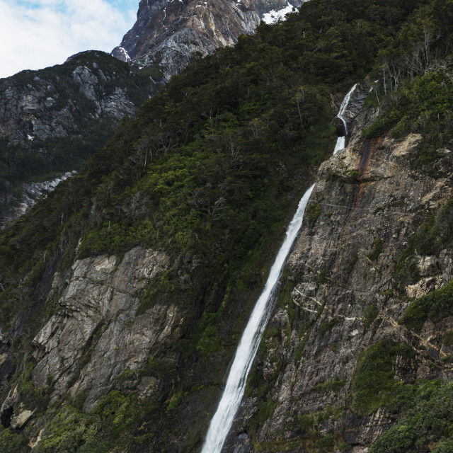 """""""Waterfall From The Side Of A Mountain Into A Lake; Natales, Magallanes And..."""" stock image"""