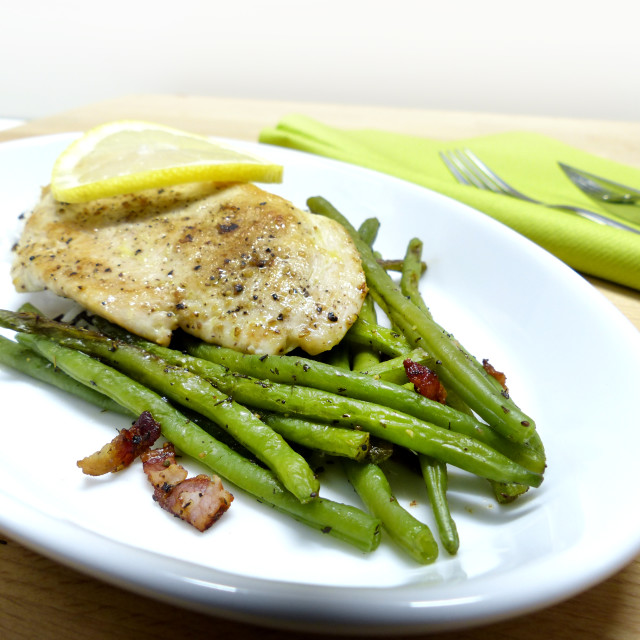 """""""Lemon cutlet with beans and bacon"""" stock image"""