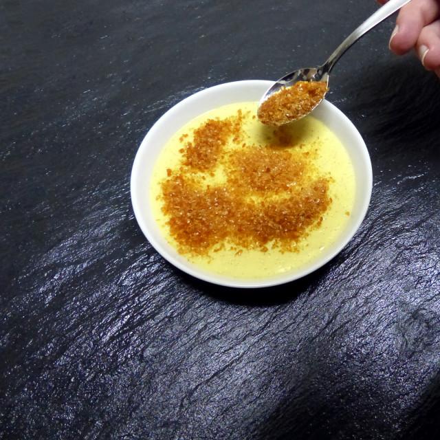 """""""Creme brulee, sprinkle with brown sugar"""" stock image"""