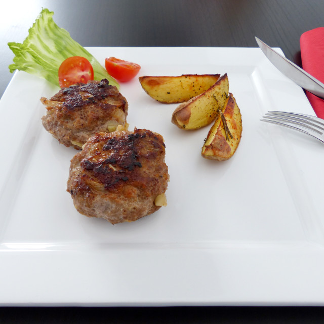 """""""Meatballs with rosemary potatoes dressed on a square plate"""" stock image"""