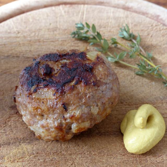 """""""Meatballs on wooden board with mustard"""" stock image"""