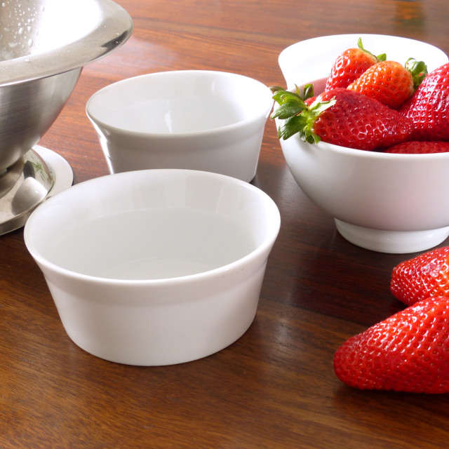 """""""Panna Cotta Ingredients strawberries and white bowls"""" stock image"""