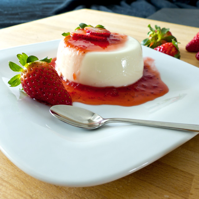 """""""Panna cotta on a plate and wooden board"""" stock image"""
