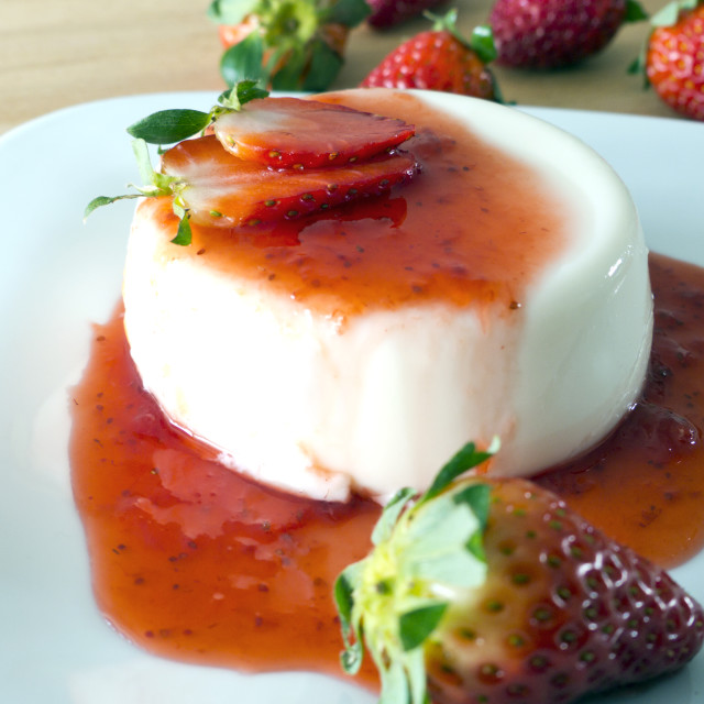 """""""Panna cotta on a plate and wood"""" stock image"""