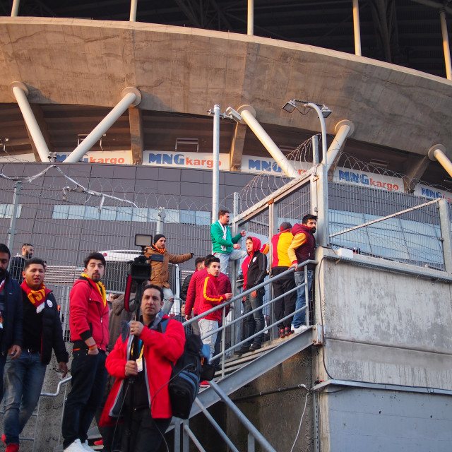 """""""Galatasaray fans try to climb fence"""" stock image"""