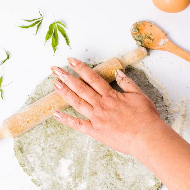 """Woman kneading dough of marijuana and wheat flour"" stock image"
