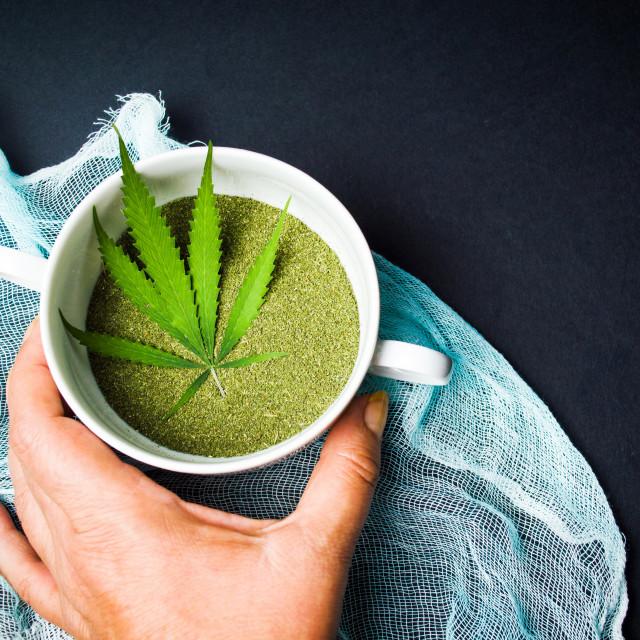 """Hand taking marijuana cannabis powder in a bowl"" stock image"