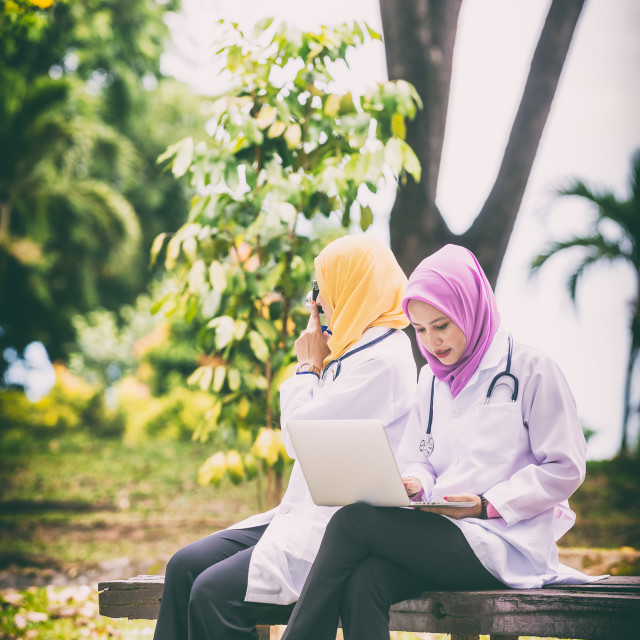"""Asian Female Doctors in a park Discussing."" stock image"