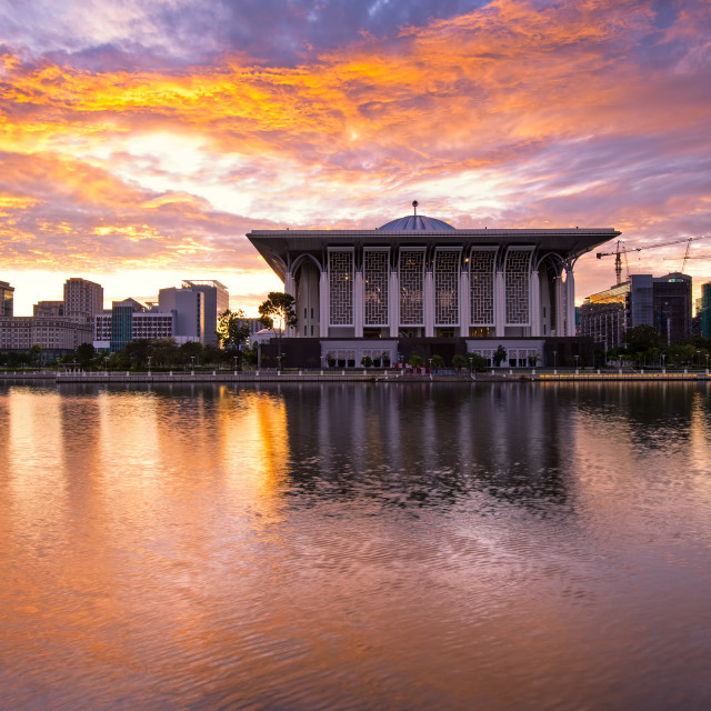 """Dramatic sunrise over Sultan Mizan Zainal Abidin mosque also known as masjid besi, located in Putrajaya, Malaysia."" stock image"