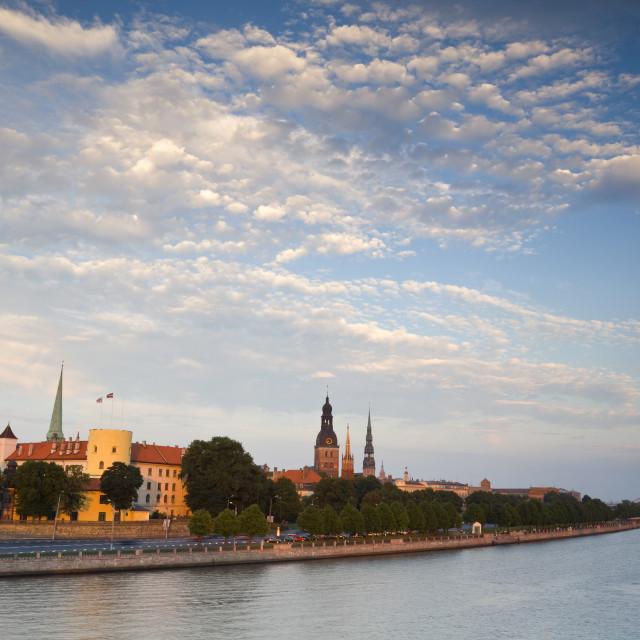 """""""Riga Castle and the River Daugava illuminated at sunset, Riga, Latvia, Europe"""" stock image"""