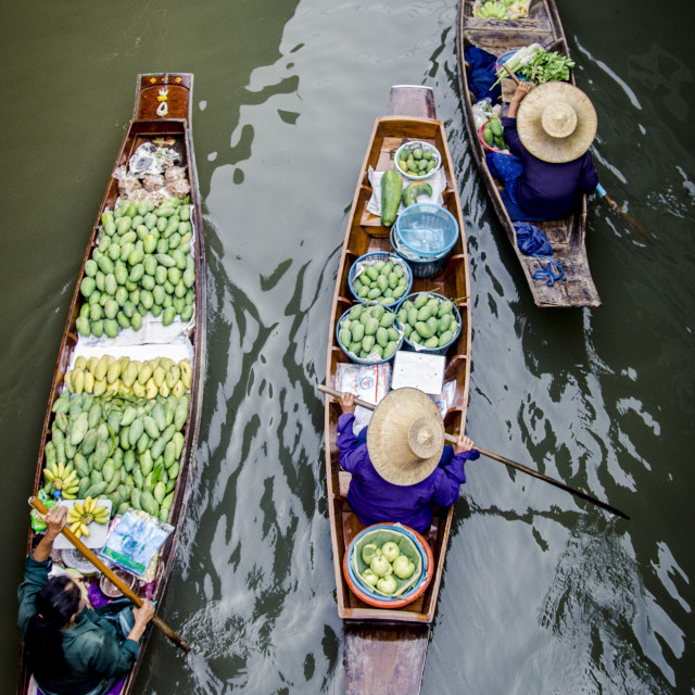 """Vendors paddle their boats, Damnoen Saduak Floating Market, Thailand,..."" stock image"