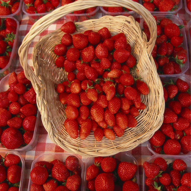 """Elevated View of Strawberries in a Basket and Boxes"" stock image"