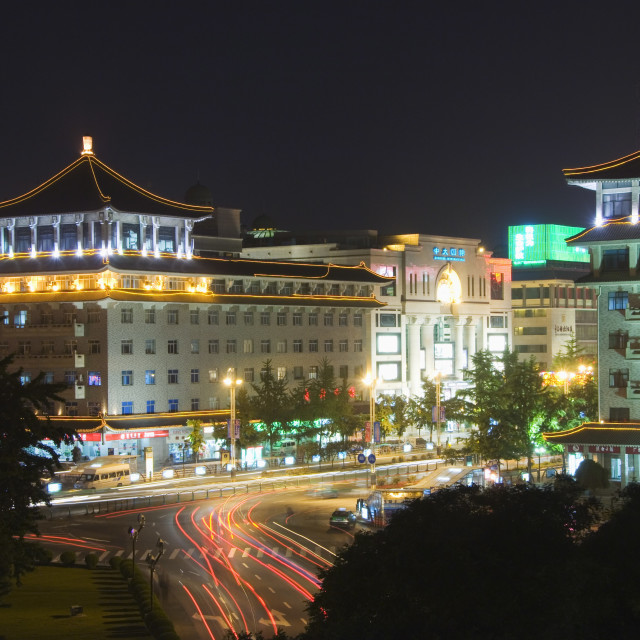 """Chinese style hotel building and city lights, Xian City Shaanxi Province,..."" stock image"