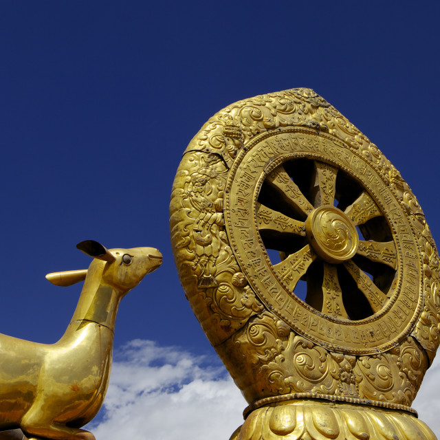"""Golden Wheel of Dharma and deer sculptures on the sacred Jokhang Temple roof,..."" stock image"