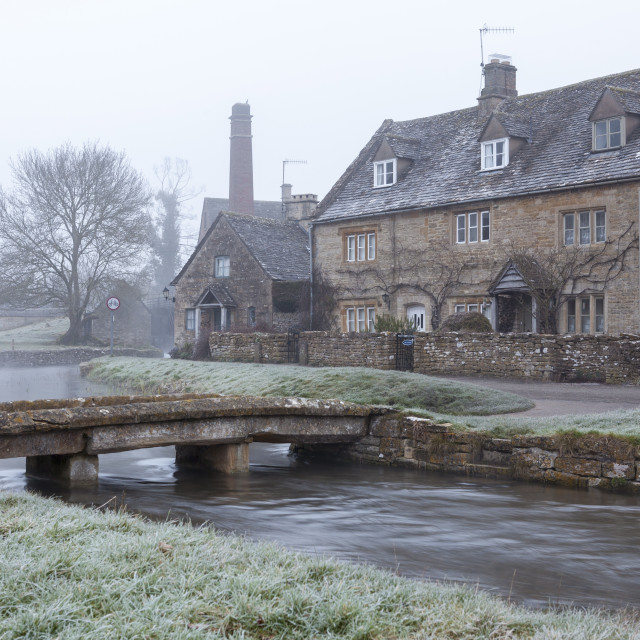 """""""A misty and frosty winters morning, Lower Slaughter, Cotswolds,..."""" stock image"""