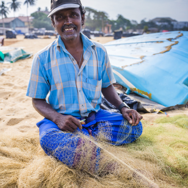 """Portrait of a fisherman mending nets in Negombo (Lellama), Sri Lanka, Asia"" stock image"