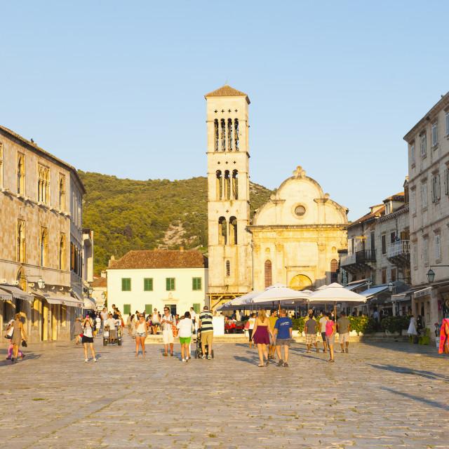"""Tourists on holiday in St. Stephens Square, Hvar Town, Hvar Island, Dalmatian..."" stock image"