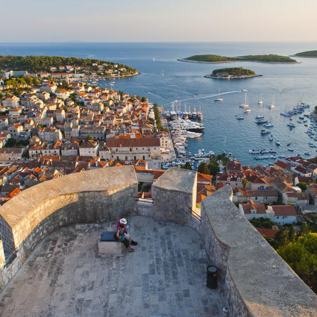 """""""Hvar Town and tourists at Hvar Spanish Fort (Fortica) at sunset, Hvar Island,..."""" stock image"""