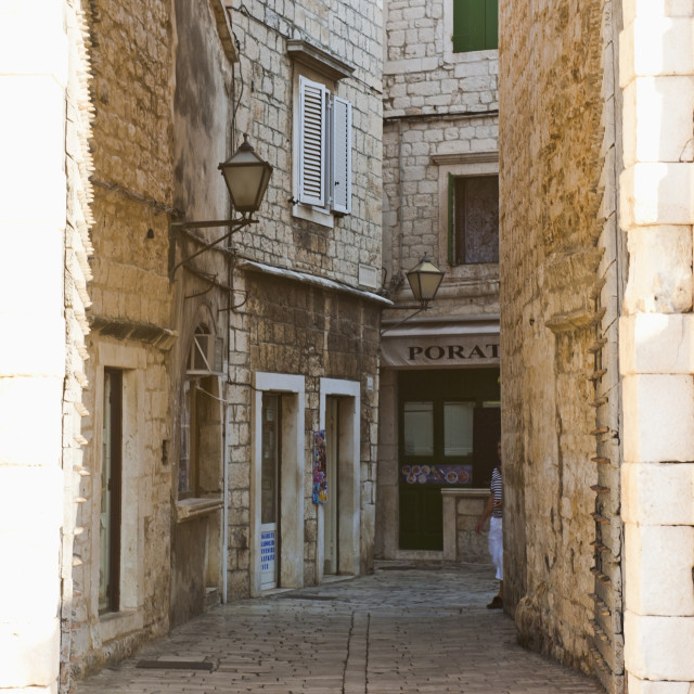 """Cobbled streets of Trogir seen through the South Town Gate, Trogir, UNESCO..."" stock image"