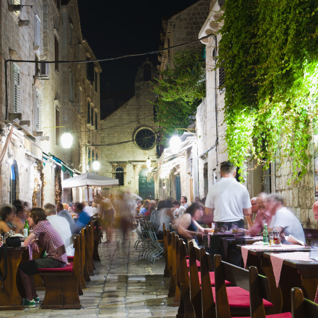 """Tourists eating dinner in a restaurant in Dubrovnik Old Town, Dalmatian..."" stock image"