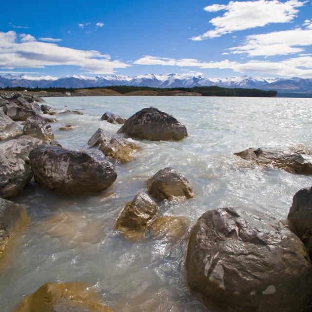 """Lake Pukaki and snow capped mountains, Aoraki Mount Cook National Park,..."" stock image"