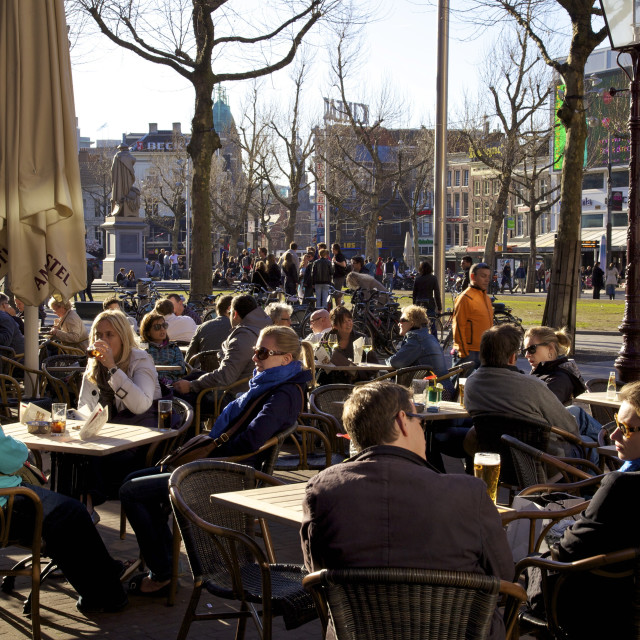 """People drinking at cafe in Rembrandtplein, Amsterdam, Netherlands, Europe"" stock image"