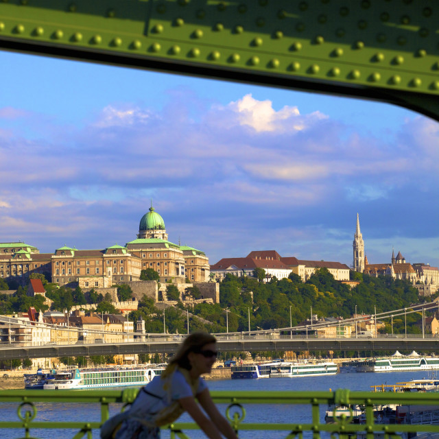"""Cyclist on Liberty Bridge, Hungarian National Gallery in background,..."" stock image"