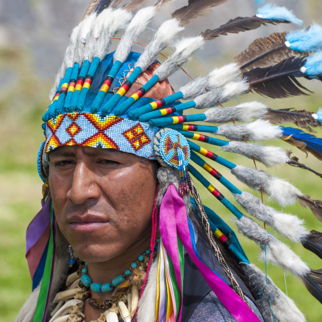 """Indigenous man wearing a feather headdress, Quito, Pichincha Province, Ecuador"" stock image"