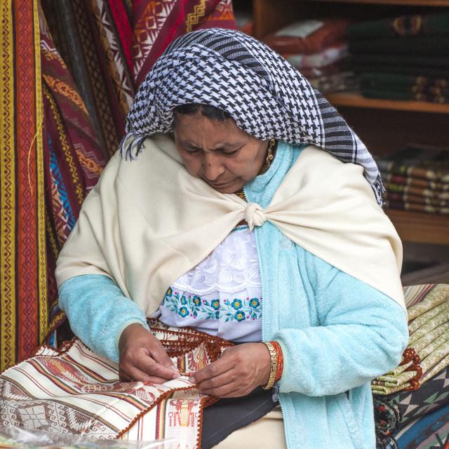 """Woman embroidering, Otavalo market, Imbabura Province, Ecuado"" stock image"