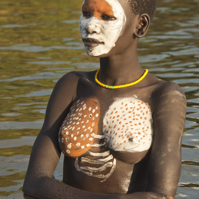 """""""Young Surma woman with body paintings in the river, Kibish, Omo River Valley,..."""" stock image"""