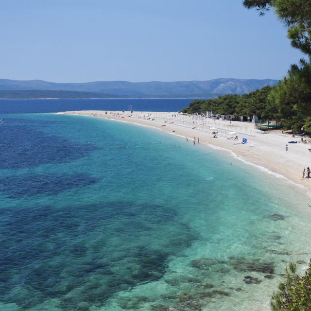"""Beach, Zlatni Rat (Golden Horn) and the island of Hvar in the background,..."" stock image"