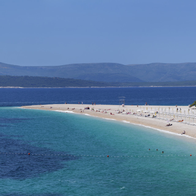 """Beach of Zlatni rat (Golden Horn) and the island of Hvar in the background,..."" stock image"