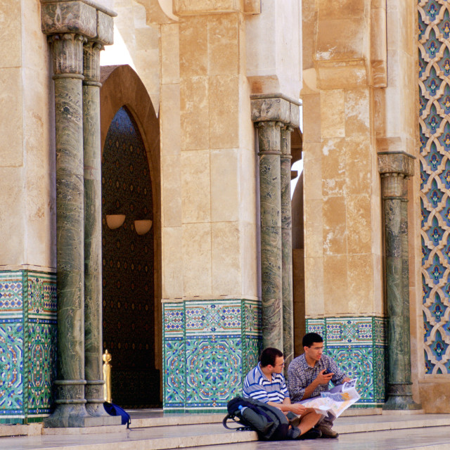 """""""Tourists sitting on the steps of King Hassan II Mosque in Casablanca, Morocco"""" stock image"""