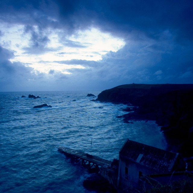 """""""Dusk at Lizard Point in Cornwall, South West England. In the foreground is..."""" stock image"""