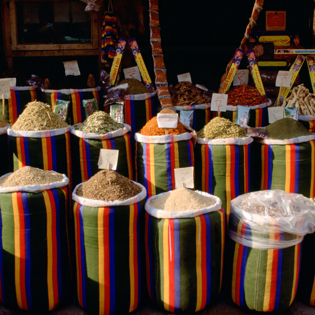 """Brightly coloured sacks of spices and nuts on sale in the Souk in Cairo, Egypt"" stock image"