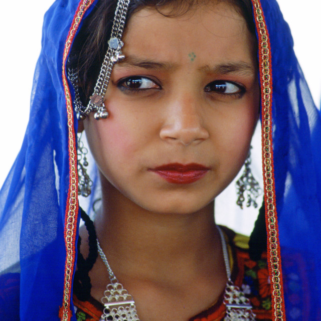 """A young girl in traditional costume with silver filigree necklace and..."" stock image"