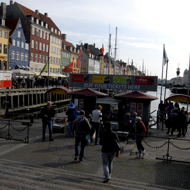 """Tourists life at Nyhavn canal"" stock image"