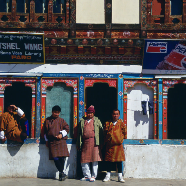 """Bhutanese men at general stores shop which sells Pepsi and rents out home..."" stock image"