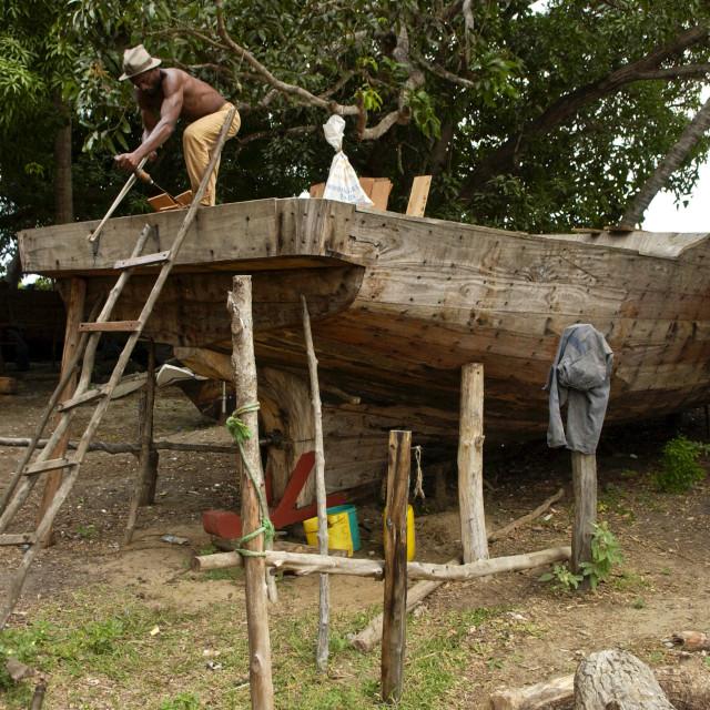 """Carpenter Building a Boat, Zanzibar"" stock image"